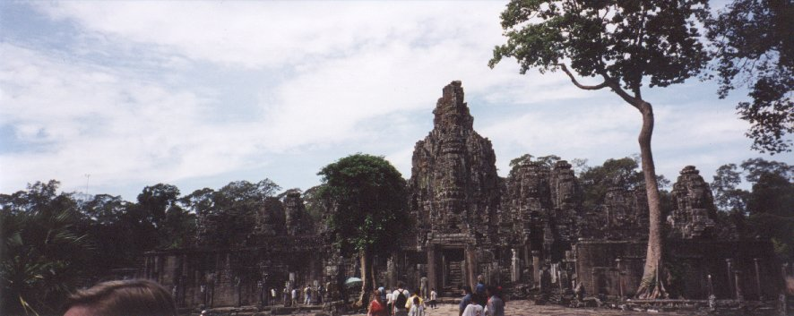 This is a panoramic view of the Bayon. This temple is a complex maze of passages and towers. Unfortunately this photo is not very clear, but it gives an idea of the Bayon's setting. The atmosphere when you enter the temple is unlike the rest of Angkor, because it feels more enclosed. This temple also contains detailed carvings on many of its walls, depicting scenes from everyday life, historic battles, and religious stories.