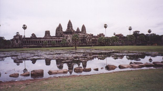 Angkor Wat is the best known of the temples at Angkor, and is even the symbol on the Cambodian national flag. This photo was taken from inside the courtyard. It shows the three tier main temple, reflected in one of the two man made lakes.
