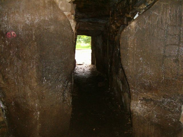 A view down the entrance tunnel of the tumulus from the main chamber.