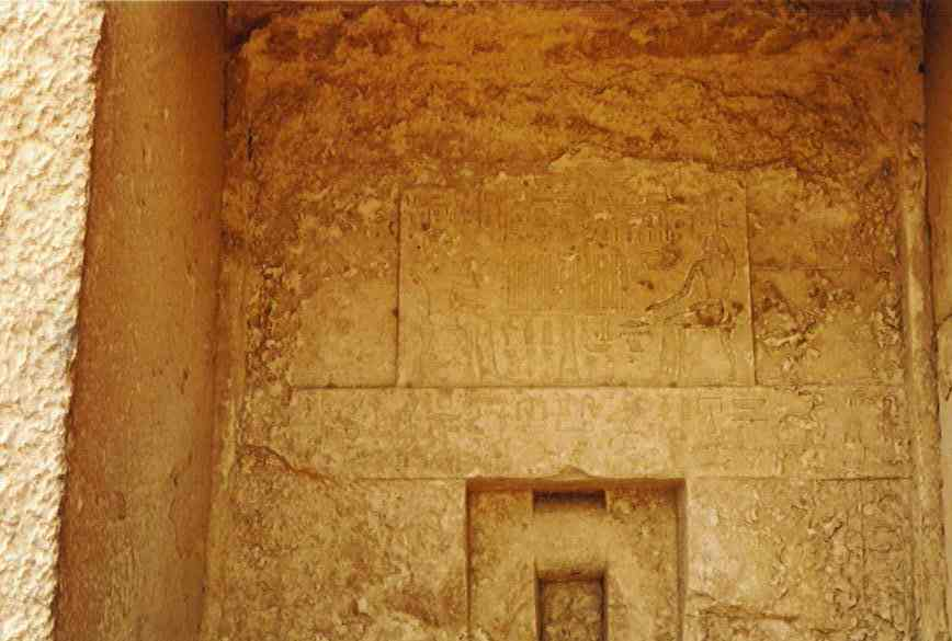 This is a picture of the decoration above the door to Heterphere's tomb which is to the east of Khufu's pyramid. This is the tomb of Khufu's mother, which was discovered in 1925. The passage leading down to the chamber is long and quite steep.