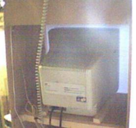 This picture (not very good quality) shows the monitor sitting on it's platform. There are two pieces of wood which hold it in position.
