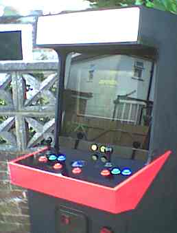 This is a closer picture showing the new control panel with the tracker ball and two new buttons. With the lights off the ball lights up nicely with a blue glow.