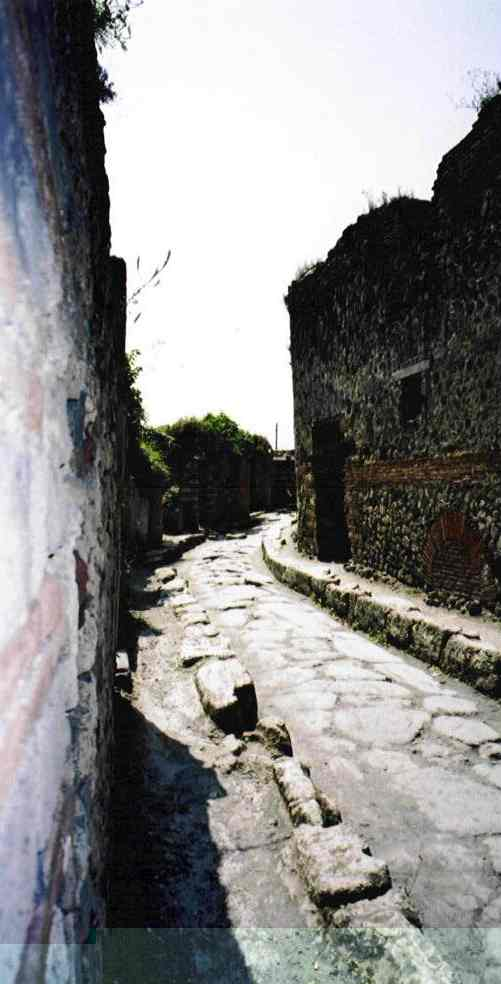Most of the roads in Pompei are straight, fitting the cliché about Roman roads, but this one disappeared around a corner, so I took a photograph of it. Unfortunately, I can't remember or work out whereabouts it is on the map.